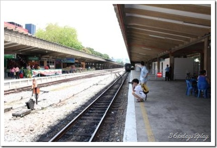 people taking pictures of the railway station before it disappears