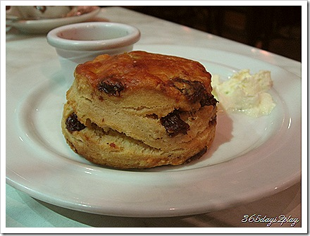 Raisin and Date Scone with Strawberry Jam and Whipped Cream - Side View