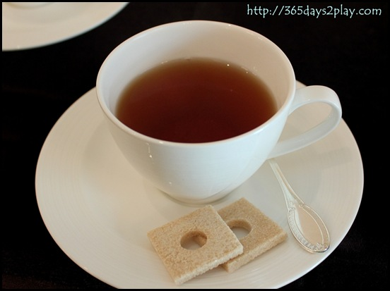Cup of tea with 2 sugar squares