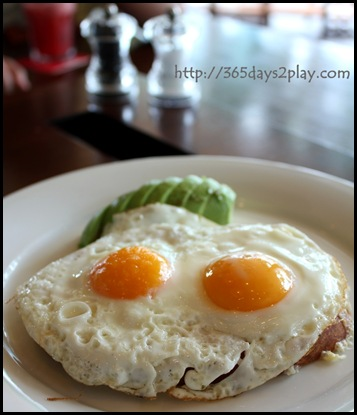 SouthCoast -Avocado, sunny side up eggs, melted cheese on sour dough
