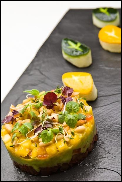 Halia Appetizer - Tian of vine ripened tomato, pine nut, guacamole & mango salsa