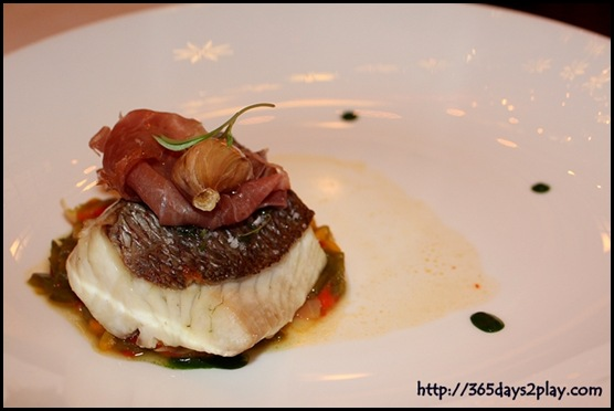 Brasserie Les Saveurs - oven-baked red snapper, confit of capsicum, parma ham and herbs coulis
