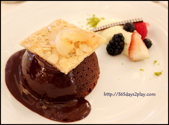 Voyager Carmen Dining Room - Warm Chocolate Cake with a milk chocolate sauce and sliced roasted pears