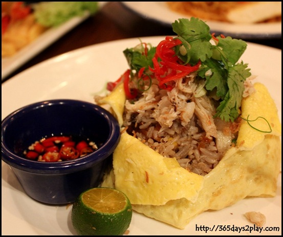 Hard Rock Cafe - Crab Fried Rice, wok fried with succulent crab meat, prawns and diced portobello mushrooms, wrapped in an egg omelette $20   (2)