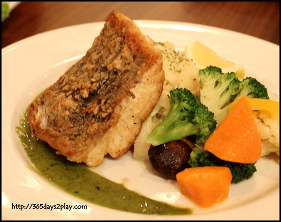 Hard Rock Cafe - Crispy Sea Bass served with Pesto Sauce, smashed potatoes and vegetables $26