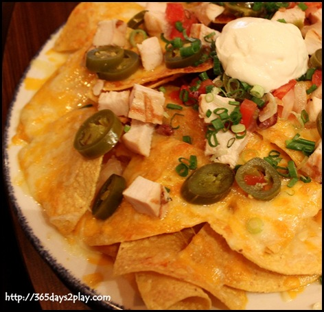 Hard Rock Cafe - Fresh corn tortilla chips piled high with Jack & Cheddar cheeses and seasoned pinto beans with addition of chicken