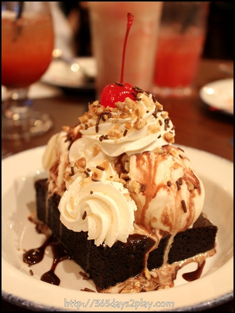 Hard Rock Cafe - Haagen-Dazs vanilla ice cream and hot fudge on a fresh brownie, topped with chopped walnuts, chocolate sprinkles, fresh whipped cream and a cherry (2)
