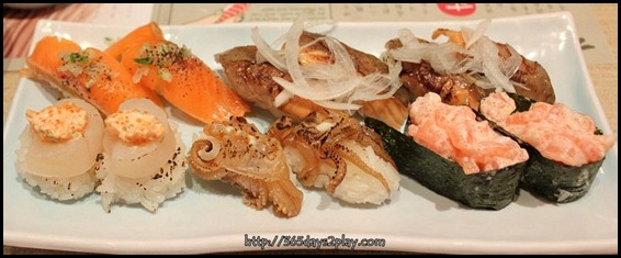 Itacho - Middle sushi is Roasted Squid Leg Sushi $1.20 U.P $2.40