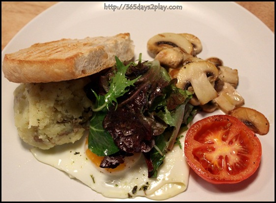 Real Food - Sunny side up with mashed herbed potatoes and sauteed wild mushrooms. served with fresh green salad and sourdough bread $9 (1)