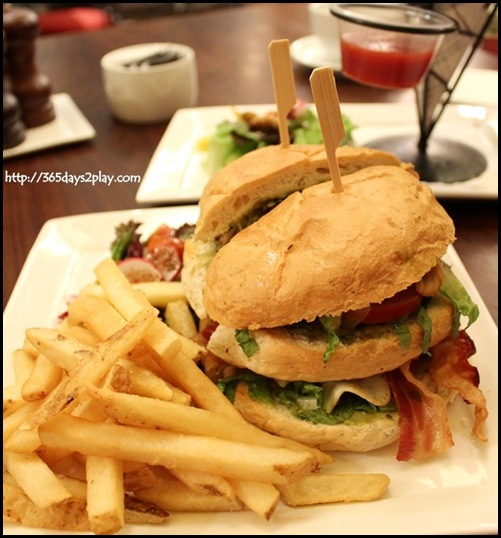 Au Chocolat Club Sandwich $20 - Traditional double decker stuffed with bacon, sunny side up egg, grilled chicken fillet & sauteed mushrooms, finished with Swiss cheese & guacamole salad