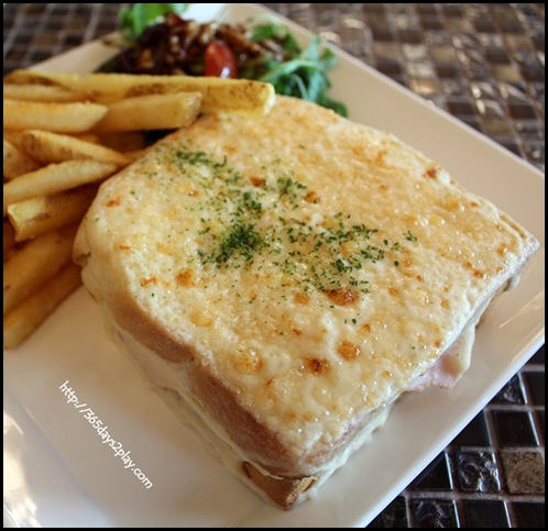 Au chocolat - Croque Monsieur $16 - Sliced ham & aged gruyere cheese between 2 slices of crusty bread, coated with creamy bechamel grilled