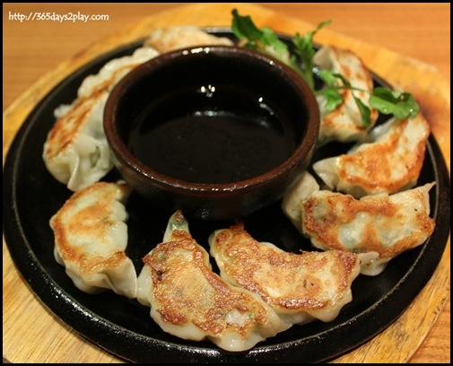 Sun Dining - Fukuoka Kurobuta Gyoza (Pan fried bite-sized Berkshire pork dumplings filled with cabbage, chives and garlic)