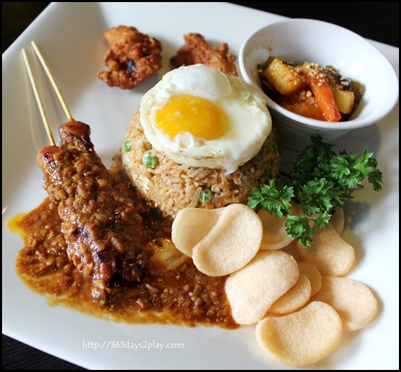 STREET 50 - Crabmeat Istimewa (Stir-fried sambal rice with crabmeat, onion and green peas accompanied by satay, chicken wings, achar, prawn crackers and fried egg) $16