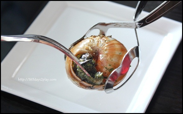 STREET 50 - Hazelnut Escargot (Slow-baked Burgundy snails stuffed with hazelnut butter and flambed with brandy) $14 (1)