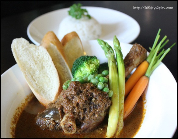STREET 50 - Lamb Rendang (Slow-braised whole lamb shank with rendang paste in claypot with carrots, potatoes, peas) $24 (2)