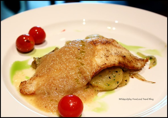 Pan seared Pacific Snapper Loin served on a bed of Lyonnais Potato and Kiwi Coulis