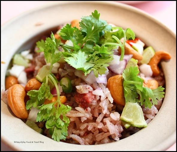 Thanying - Khao Ohb Nam-Liaeb (Black Olive rice with Minced Chicken in Claypot) $17
