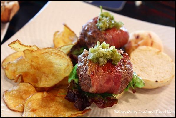 Intrepid Gastro Bar - Kangaroo Sliders – Parma ham, truffle aiolo and onion-chili relish served with a side of homemade crispy potato chips ($18.50 )
