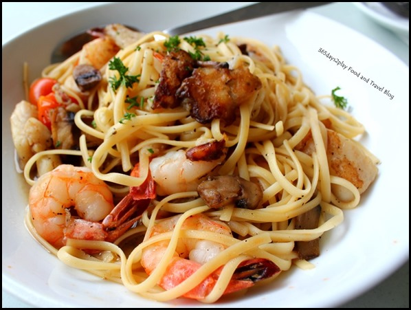 The Garden Slug - Seafood Pasta in white wine sauce with shrimp, fish, mushrooms and cherry tomatoes $17