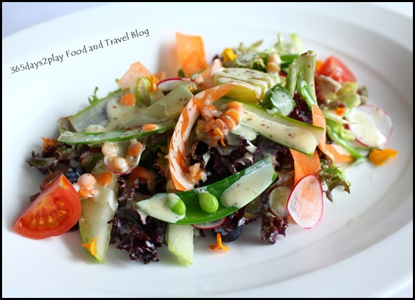Au Jardin - Mesclun salad with shaved vegetables, marinated lentils, seasonal fruits and honey mustard dressing