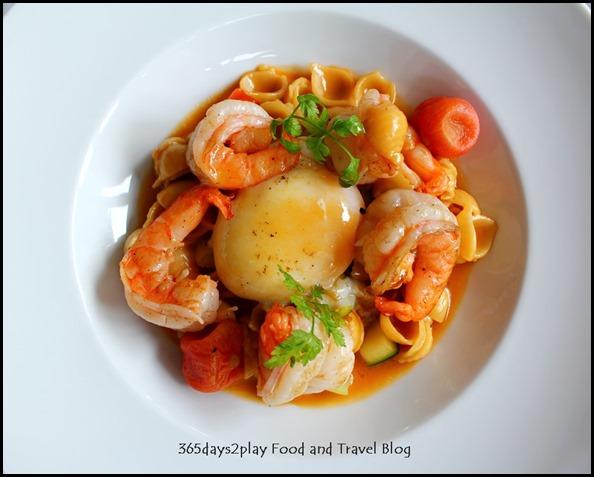 Au Jardin - Prawn a la plancha, egg confit, shell pasta and seasonal vegetables in shellfish glaze (1)
