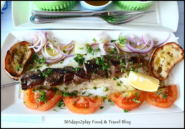 Blu Kouzina -Kalamaki Souvlaki - Beef skewers served with fresh onion, sliced tomato, in-house bread and lemon $12 (5)