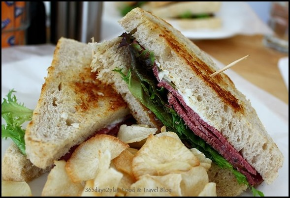 Fabulous Baker Boy - Beef Pastrami Sandwich (beef pastrami topped with caramelised onions mesclun, sriracha on sour dough, casava chips) $14 (2)