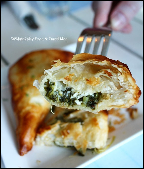 Spanakopita cut in halves