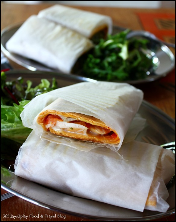 Peloton - Smoked Chicken Tortilla with Mango Chutney, Massdam cheese, tomatoes and lettuce $6