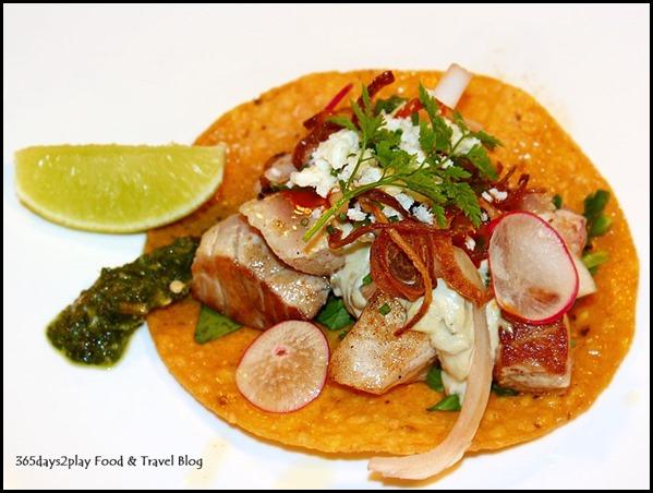 Seasons Bistro-     Seared Yellowtail Tuna Taco ($14  ) - Avocado mayonnaise, pickled onions, crispy shallots, cotija cheese and cilantro jalapeno watercress salad on tortilla shell