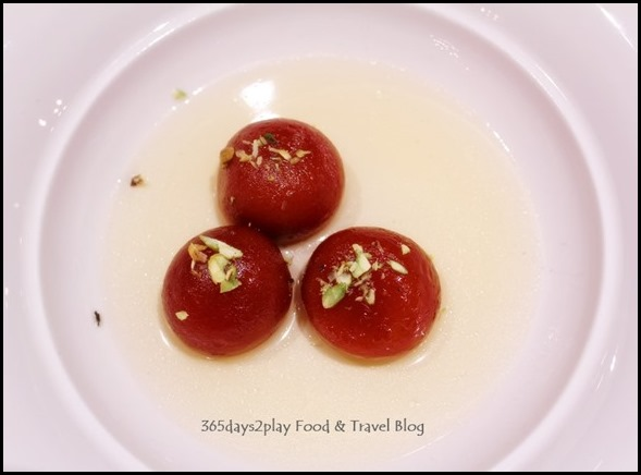 Gulab Jamun - Reduced milk balls; soaked in rose flavoured syrup