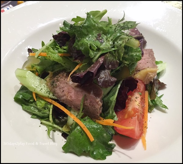 Paul Singapore -  Grilled beef with gherkins, carrots, tomato vine, cherry tomatoes, red onions, cucumbers and mixed salad