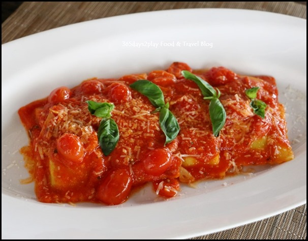Pepenero - Homemade ravioli filled with ricotta cheese served in tomato sauce and basil $24