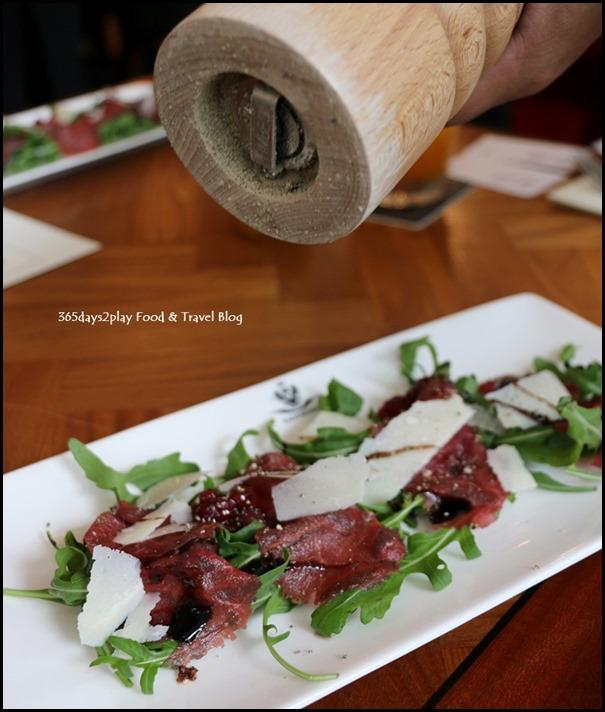 Kaiserhaus - Venison Carpaccio (Thinly sliced venison loin with rocket and parmesan shavings) $25