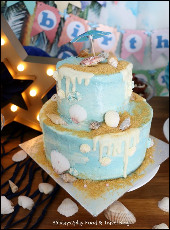 Seaside-themed drips birthday cake
