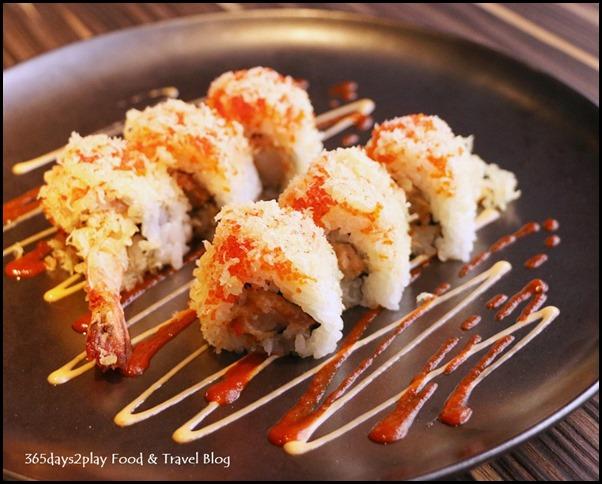 Izy Dining & Bar - Crunch Roll (Tempura shrimp, flying fish roe, avocado & spicy sauce topped with tempura bits) $15