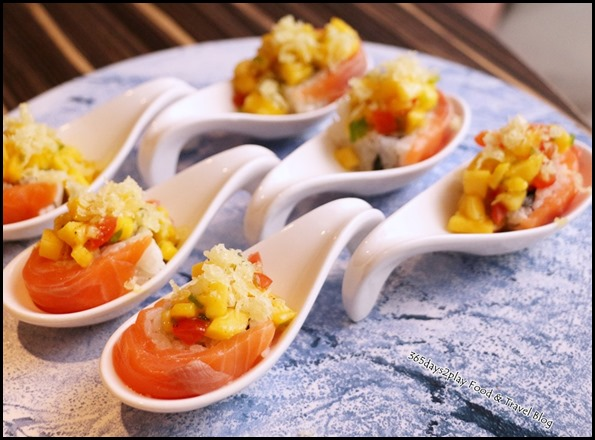 Izy Dining & Bar - Mango Salsa Roll (Tempura shrimp, raw salmon & avocado topped with mango salsa sauce) $18