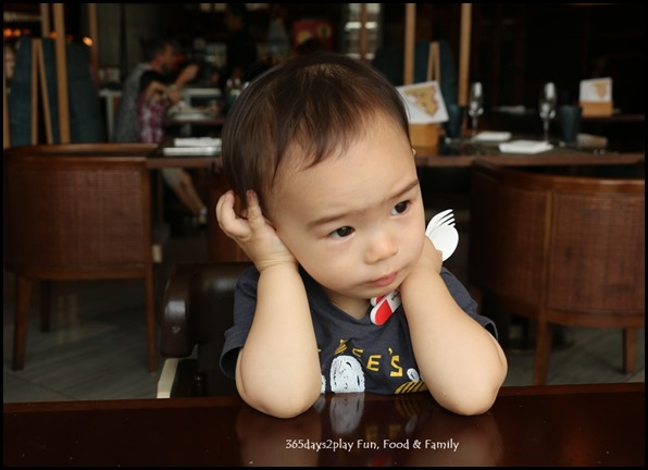 Bored Toddler waiting for food (1)
