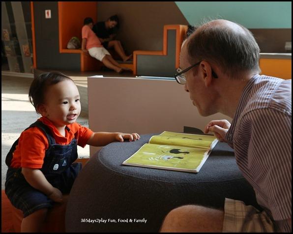 Edward reading books at Pasir Ris Library