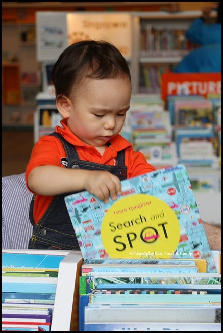 Toddler browsing for books