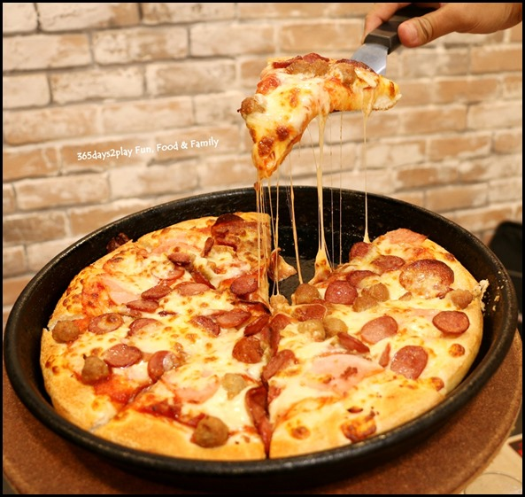 Pizza Hut - Meat Galore Pizza Cheese Pull